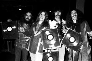 Black Sabbath pose for a group portrait with gold discs, London, 1973, L-R Bill Ward, Ozzy Osbourne, Tony Iommi, Geezer Butler. (Photo by Michael Putland/Getty Images)