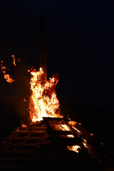 <big><big>The guitar burned after several minutes, but the fire lasted all night!