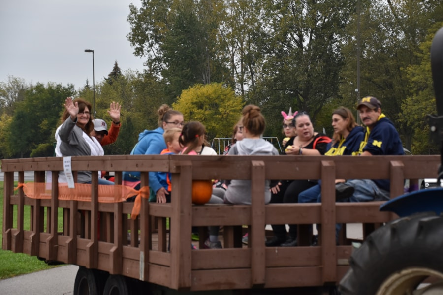 <big><big>Fall festivities aren't complete without a tractor ride!